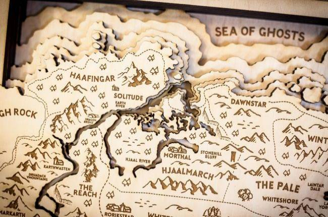 These handcrafted wood maps of video game worlds are excellent